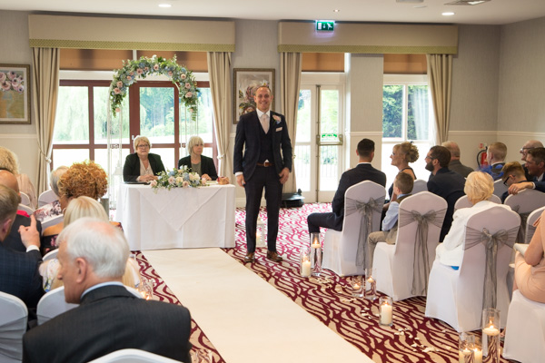 THe groom in the ceremony room at Bagden Hall Hotel Wedding