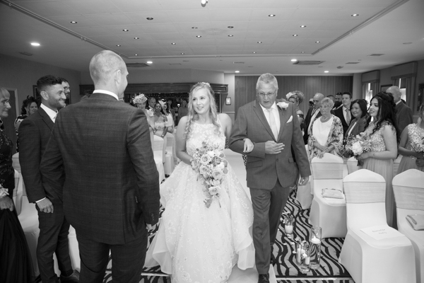 THe bride walking down the aisle at Bagden Hall Hotel Wedding