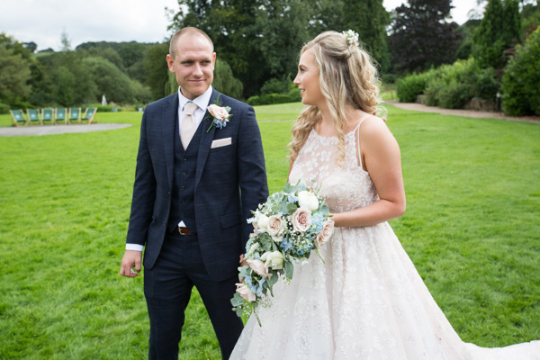 Bride and Groom walking at Bagden Hall hotel Wedding