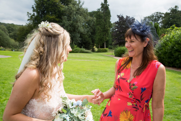 Bride laughing with guests at Bagden Hall hotel Wedding