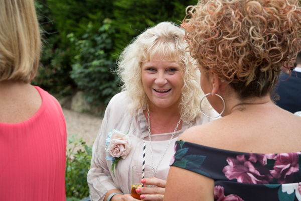 Mother of the bride laughing at Bagden Hall hotel Wedding