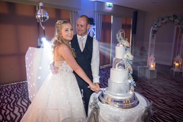 Bride and Groom cut the cake at Bagden Hall Hotel Wedding