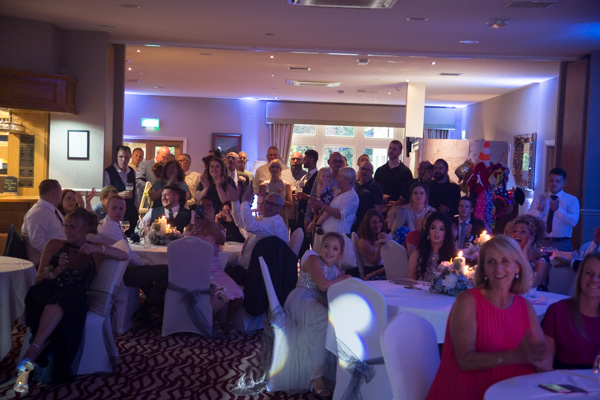 Guests watching the cutting of the cake at Bagden Hall Hotel Wedding