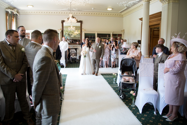Bride walking down the aisle at Wortley Hall Wedding How To Choose Your Wedding Guest List