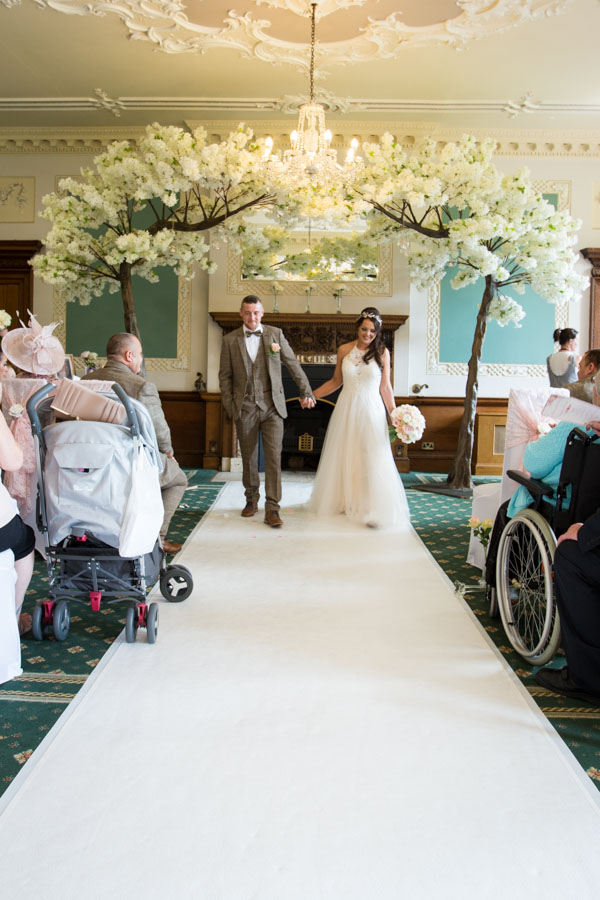 Bride and groom leaving the wedding ceremony room at Wortley Hall Wedding Exit Songs