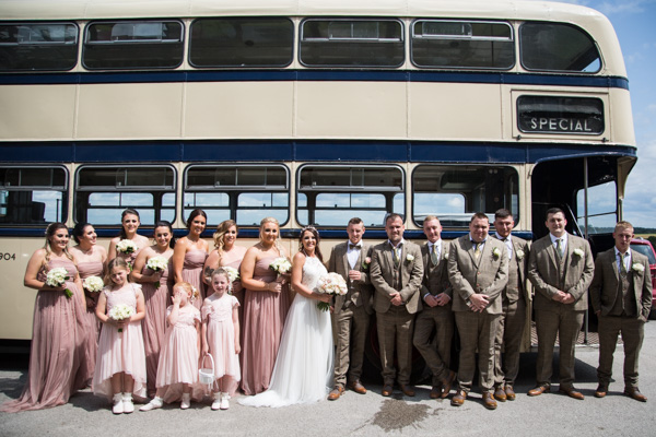 Bridesmiads and groomsmen next to the double decker bus at Wortley Hall Wedding
