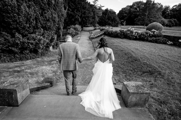 Bride and groom walking through the grounds at Wortley Hall Wedding