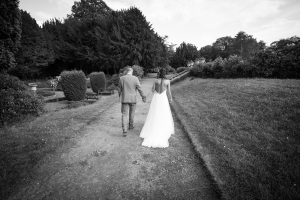The bride and groom walking through the grounds at Wortley Hall Wedding