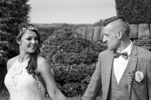Bride and groom walking with each other at Wortley Hall Wedding