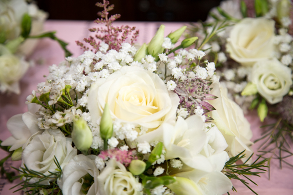 white roses in bridal bouquet at Whitley Hall Hotel Wedding