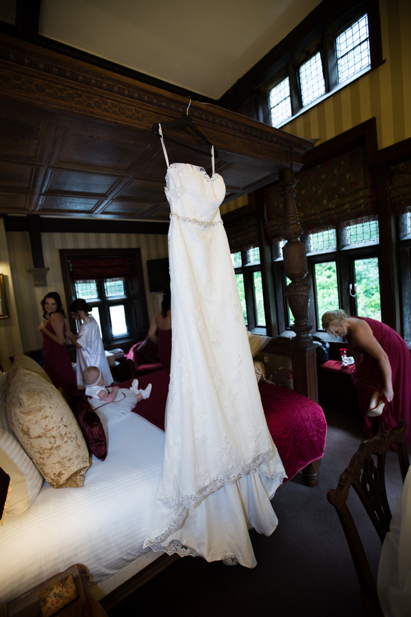 Bridesmaids getting ready where the dress hangs at Whitley Hall Hotel Wedding