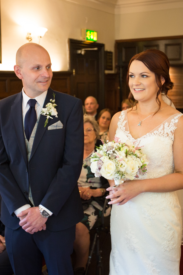 Briode and groom at the altar at Whitley Hall Hotel Wedding