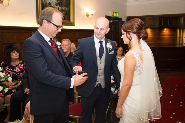 Best man giving the rings to the groom at Whitley Hall Hotel Wedding