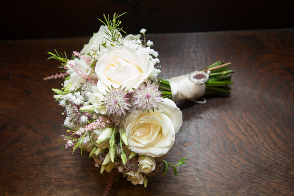 THe bridal bouquet with picture charm at Whitley Hall Hotel Wedding