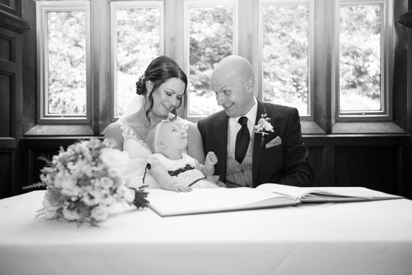 Signing the register at Whitley Hall Hotel Wedding