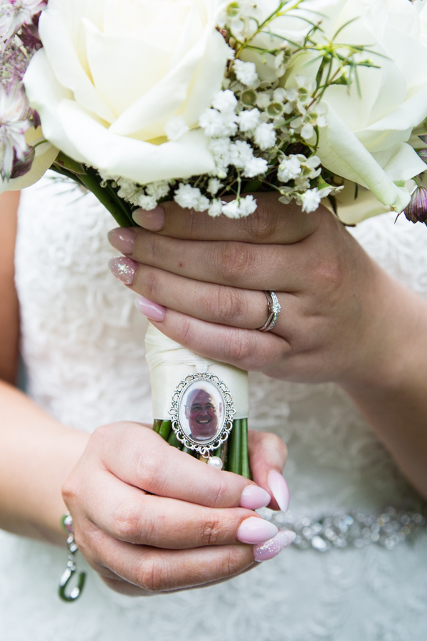 Bride showing off bouquet details at Whitley Hall Hotel Wedding