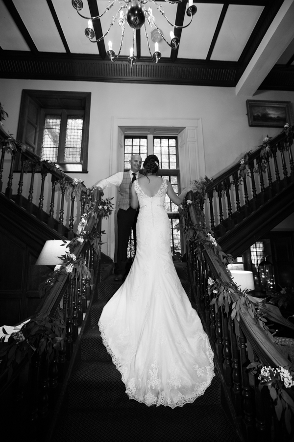 Bride and groom on the stairs at Whitley Hall Wedding