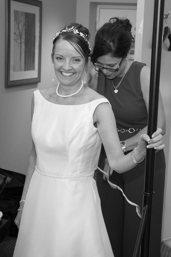 Bridesmaid fastening the bridal gown 315 Wedding Huddersfield