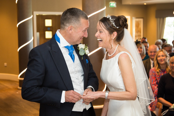 BRide and groom laugh during the wedding ceremony 315 Wedding Huddersfield