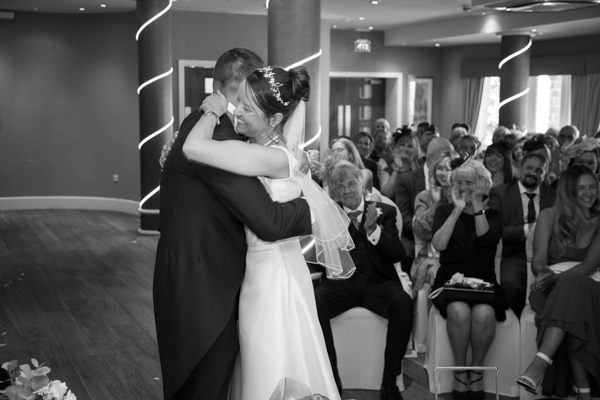 BRide and groom hug during the wedding ceremony 315 Wedding Huddersfield