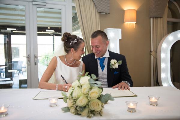 BRide and groom signing the register 315 Wedding Huddersfield