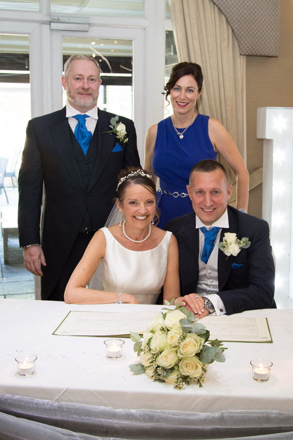 Bride and groom with the witnesses around the wedding register 315 Wedding Huddersfield