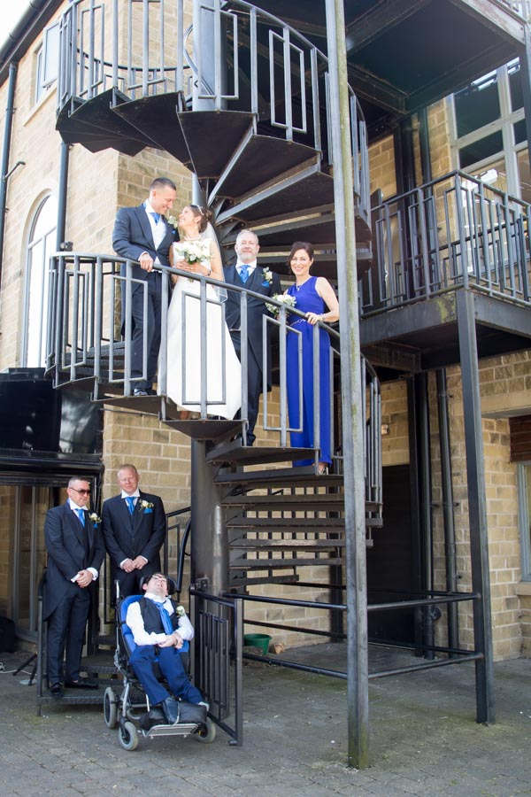 Wedding party on the spiral staircase 315 Wedding Huddersfield