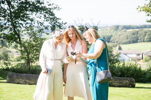 planning destination wedding Guests looking at their photographs 315 Wedding Huddersfield