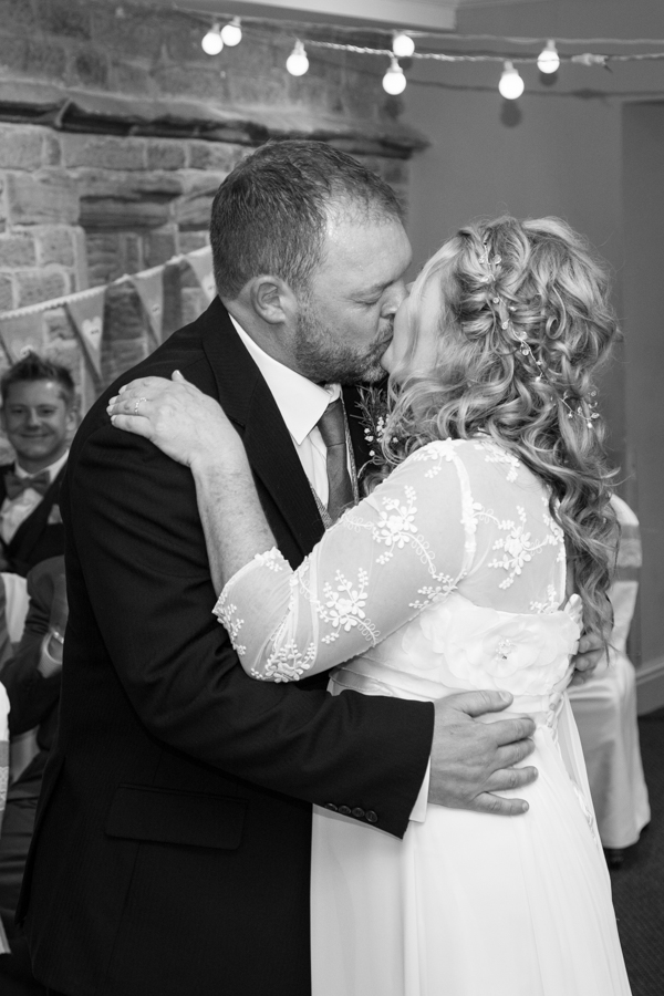 Bride and groom kiss at Whitley Hall Wedding
