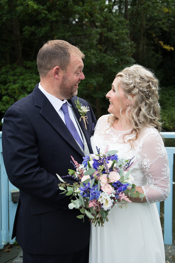 Bride and Groom on bridge at Whitley Hall Hotel Wedding