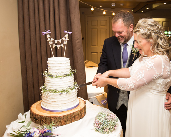 Bride and Groom cutting cake at Whitley Hall Hotel