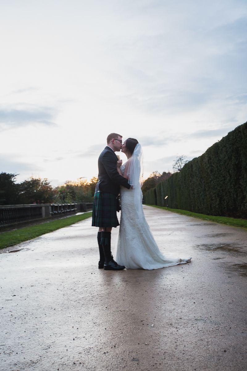 Bride and groom kissing at Yorkshire Sculpture park on their wedding day