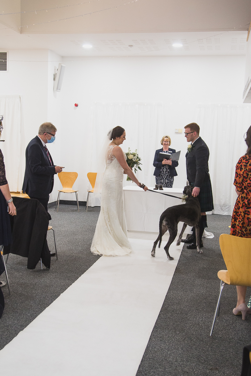 Bride and Grom with their dog at the altar at Yorkshire Sculpture Park Wedding
