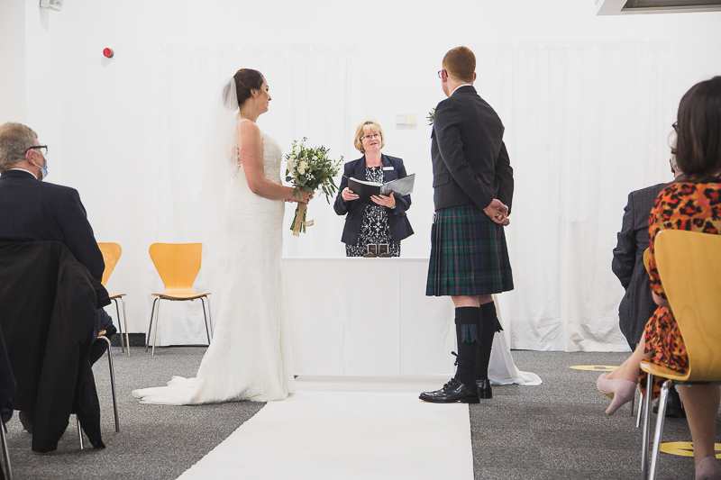 Bride and Groom exchange vows in Roger Evans Auditorium YSP
