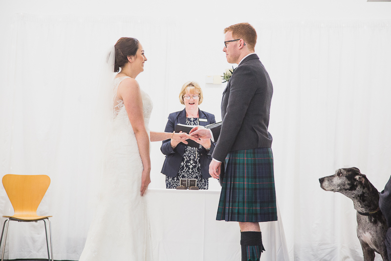 COuple exchanging rings at Yorkshire Sculpture Park Wedding