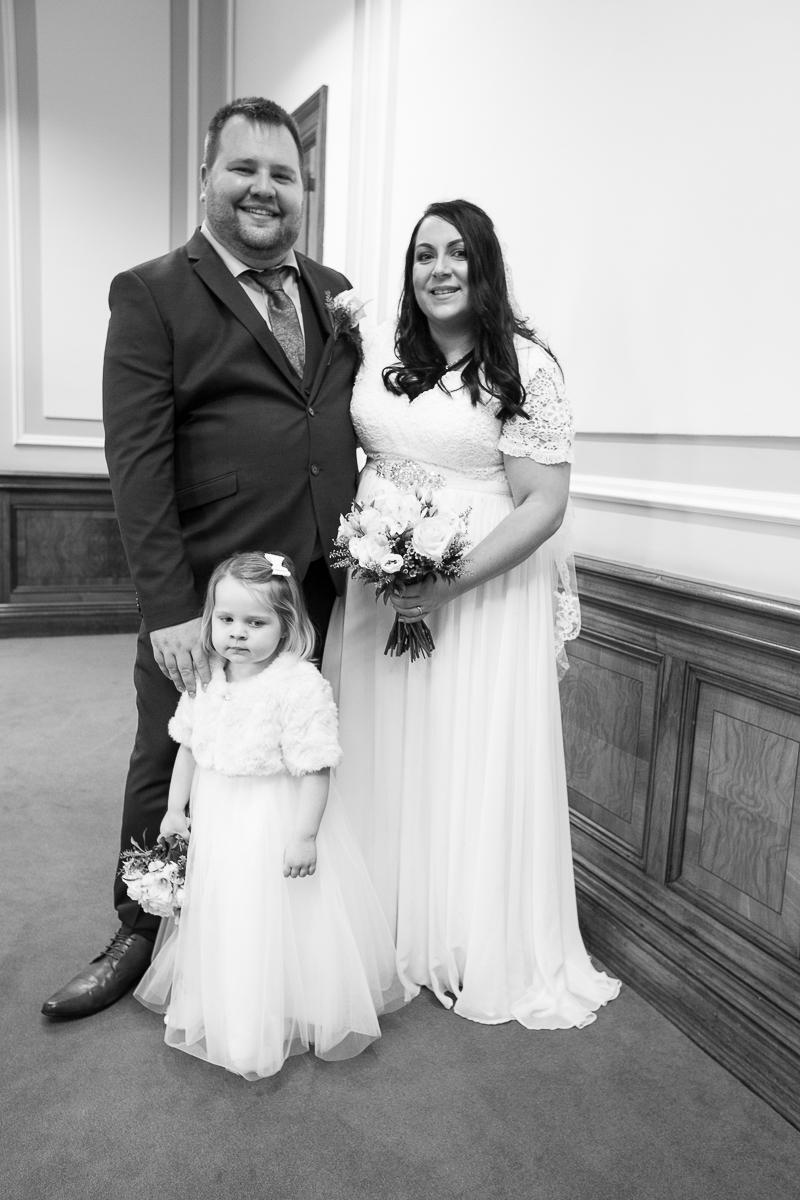 Couple with flower girl at Barnsley Town Hall Wedding