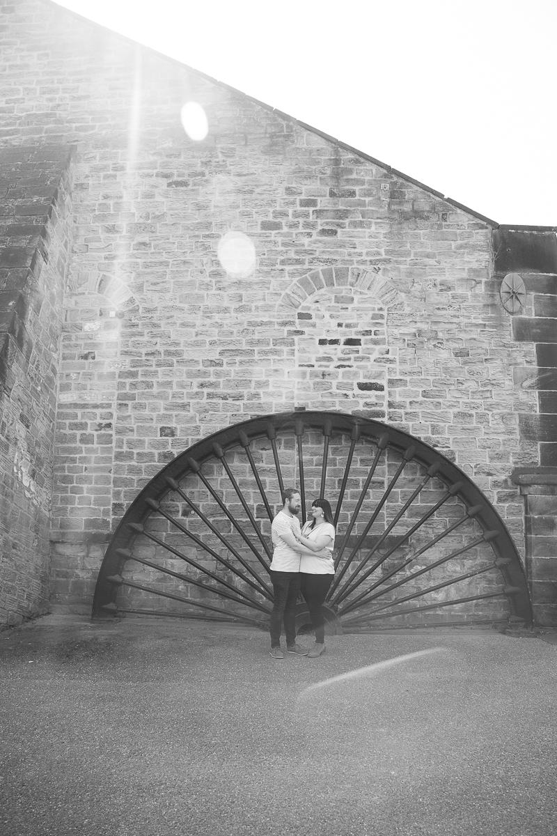 Couple next to the old wheel at Elsecar Heritage centre on their pre-wedding shoot