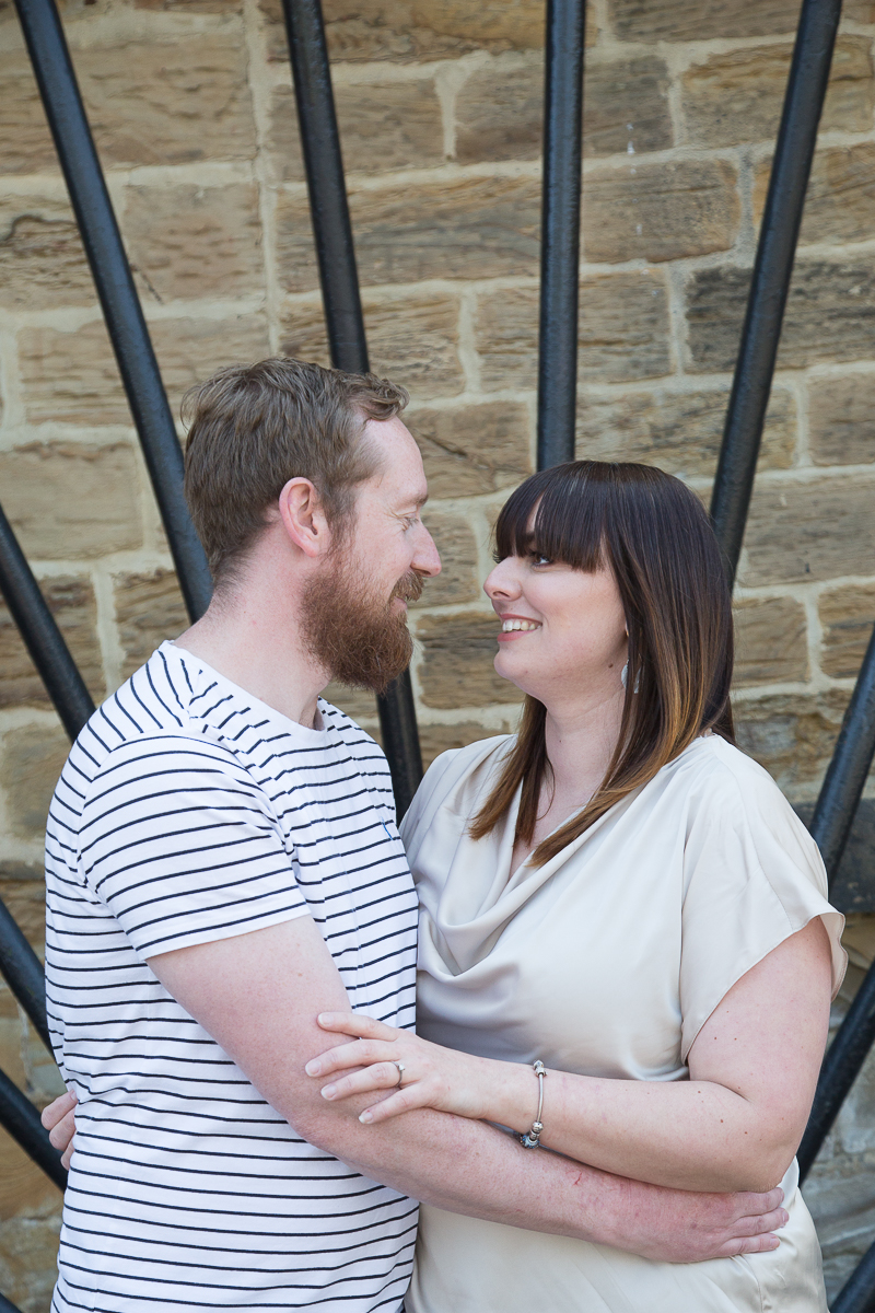 Couple looking at each other in Elsecar before their wedding