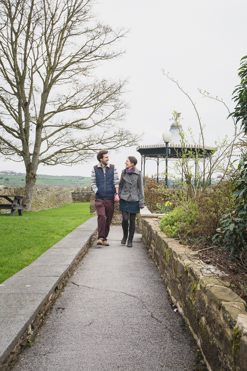Couple walking at Cubley Hall Hotel before their wedding