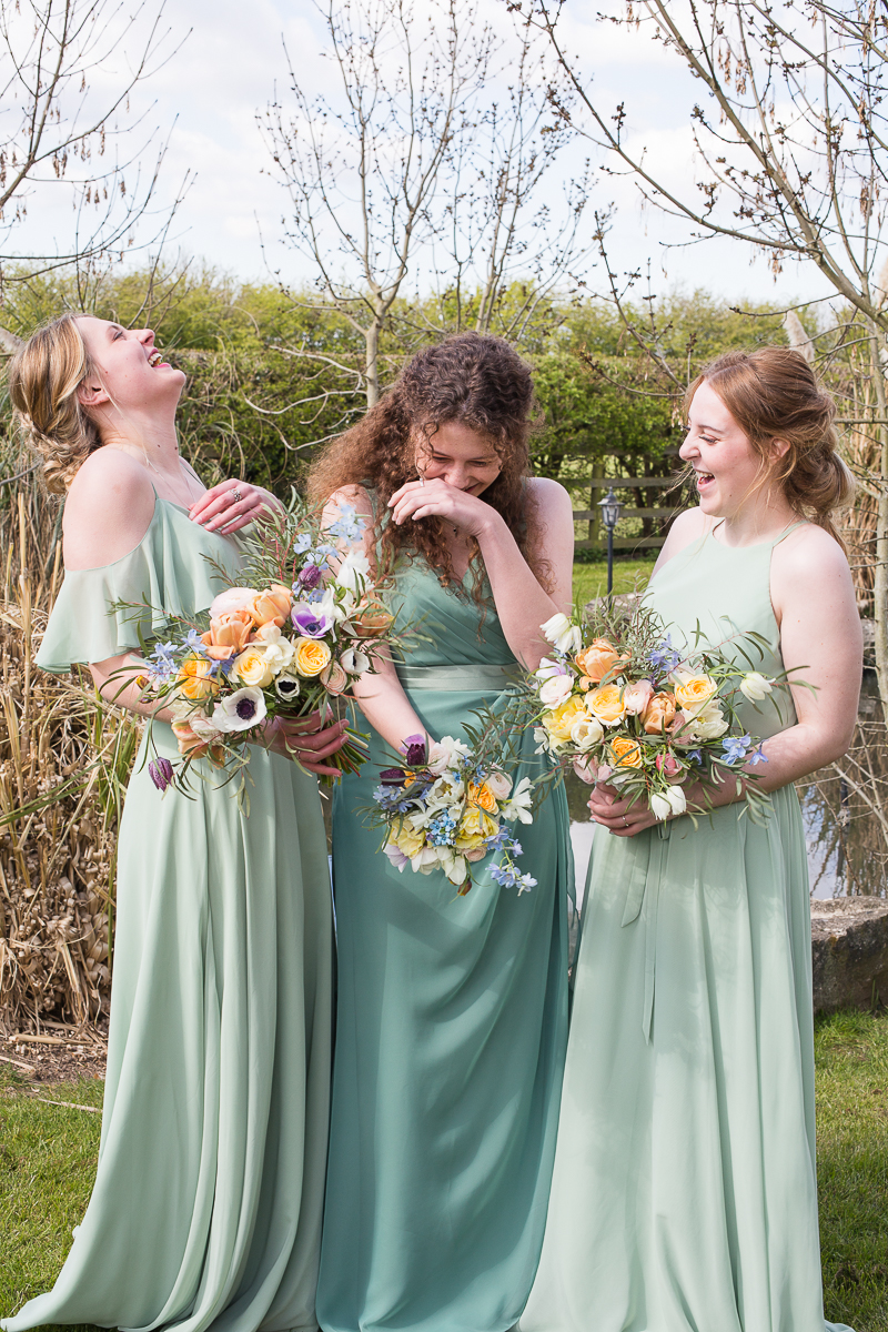 Bridesmaids laughing during a styled shoot at Fishlake Mill Wedding Venue Doncaster