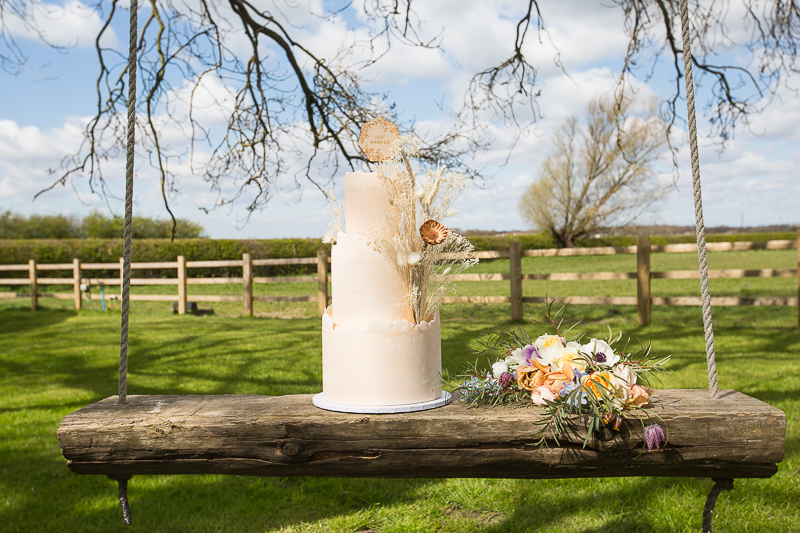 WEdding cake by Katrinas Bespoke cakes on cake stand by Olive May floral Design