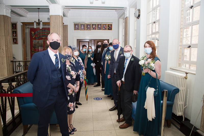 Guests waiting to go into the ceremony room at Barnsley Town Hall during a covid restricted wedding