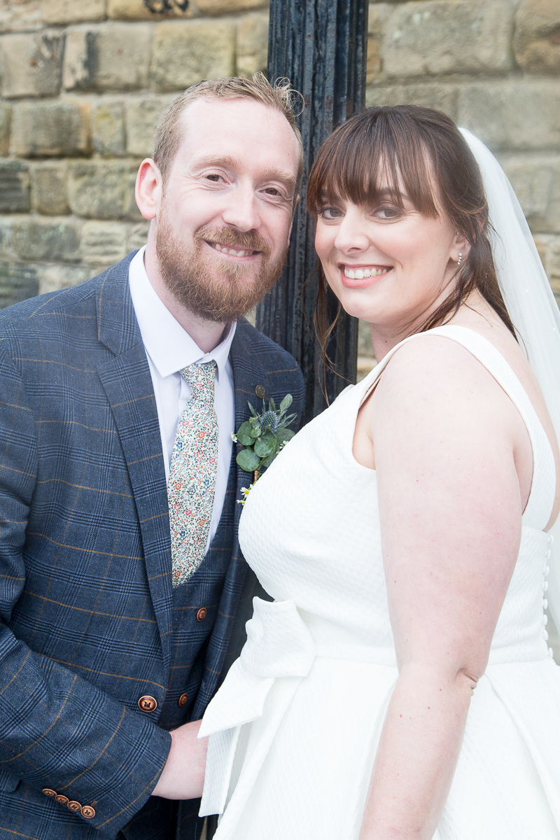 Couple next to a lamp post at Elsecar Heritage Centre on their wedding day