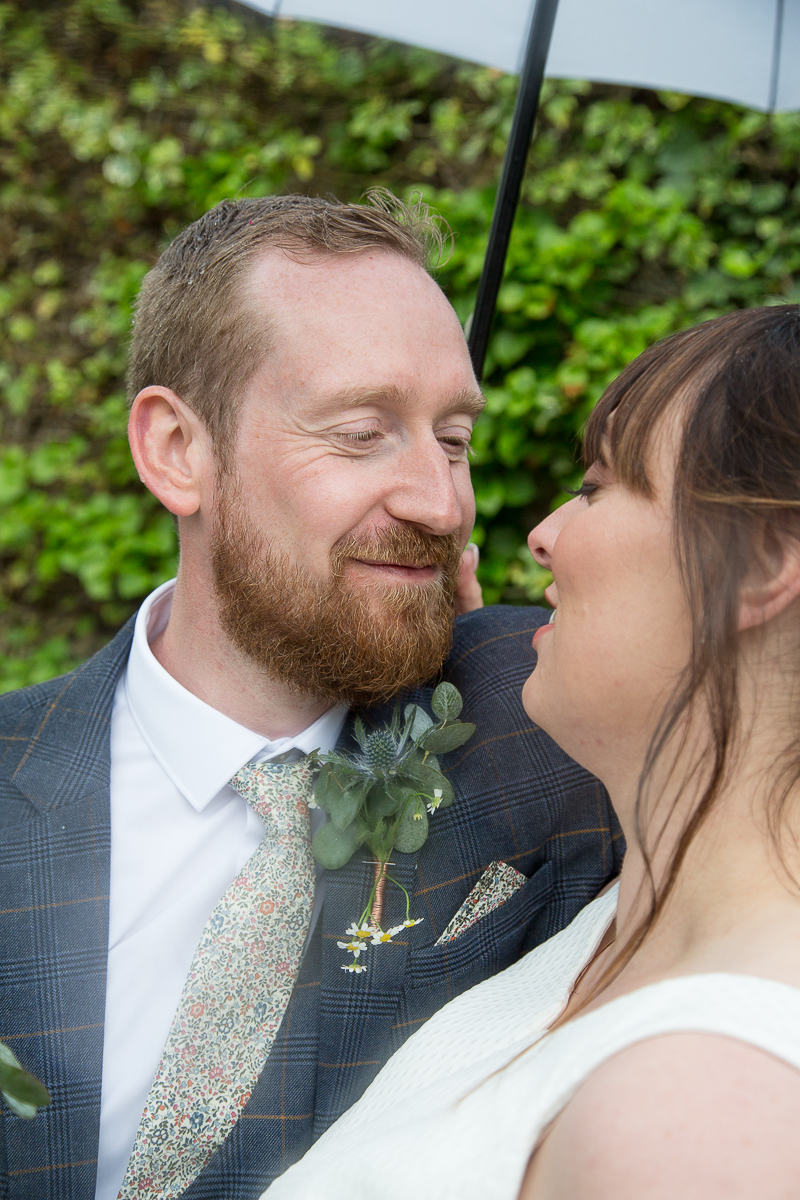 Bride and Groom on their rainy wedding day at Elsecar Heritage Centre