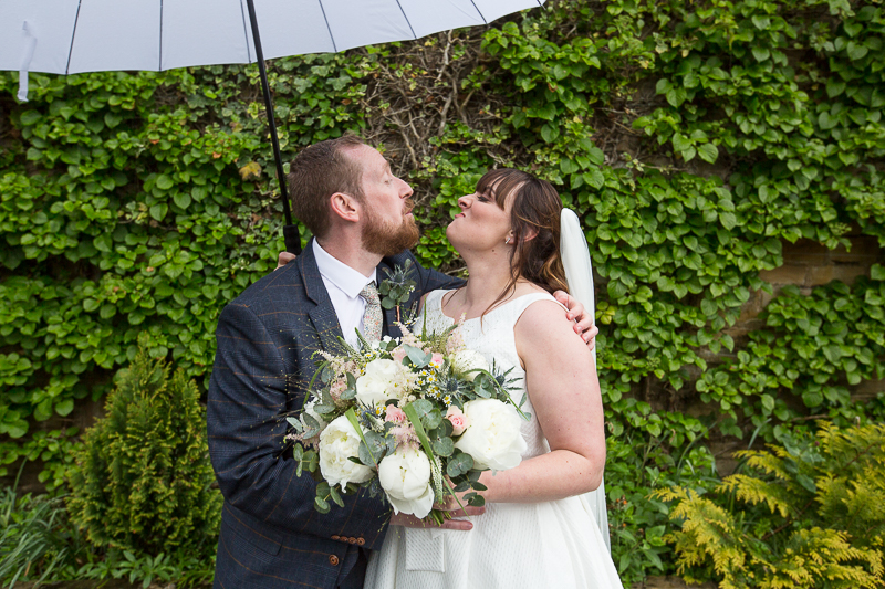 Couple pull faces at each other on their wedding day at Elsecar Heritage Centre