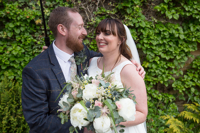 Couple smiling at Elsecar Heritage Centre on their wedding day