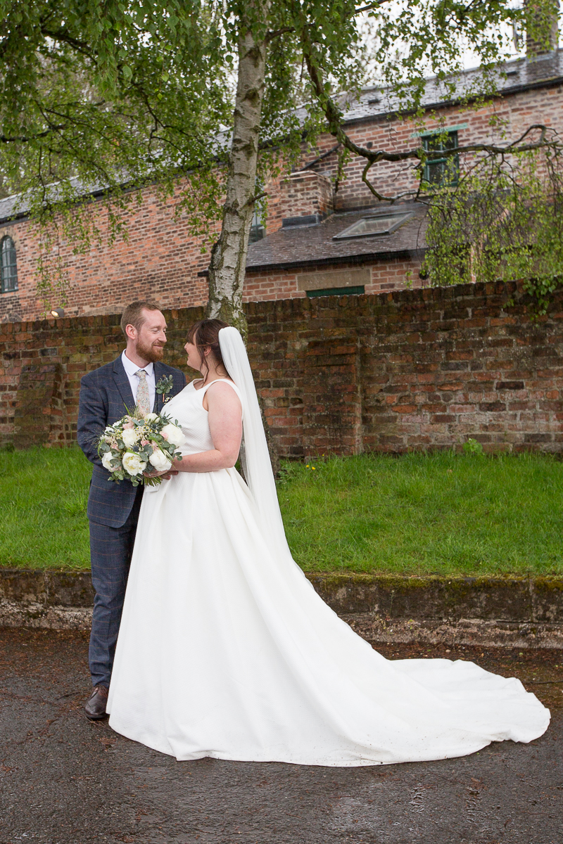 Bride and groom near the trees at Elsecar Heritage Centre on their wedding day