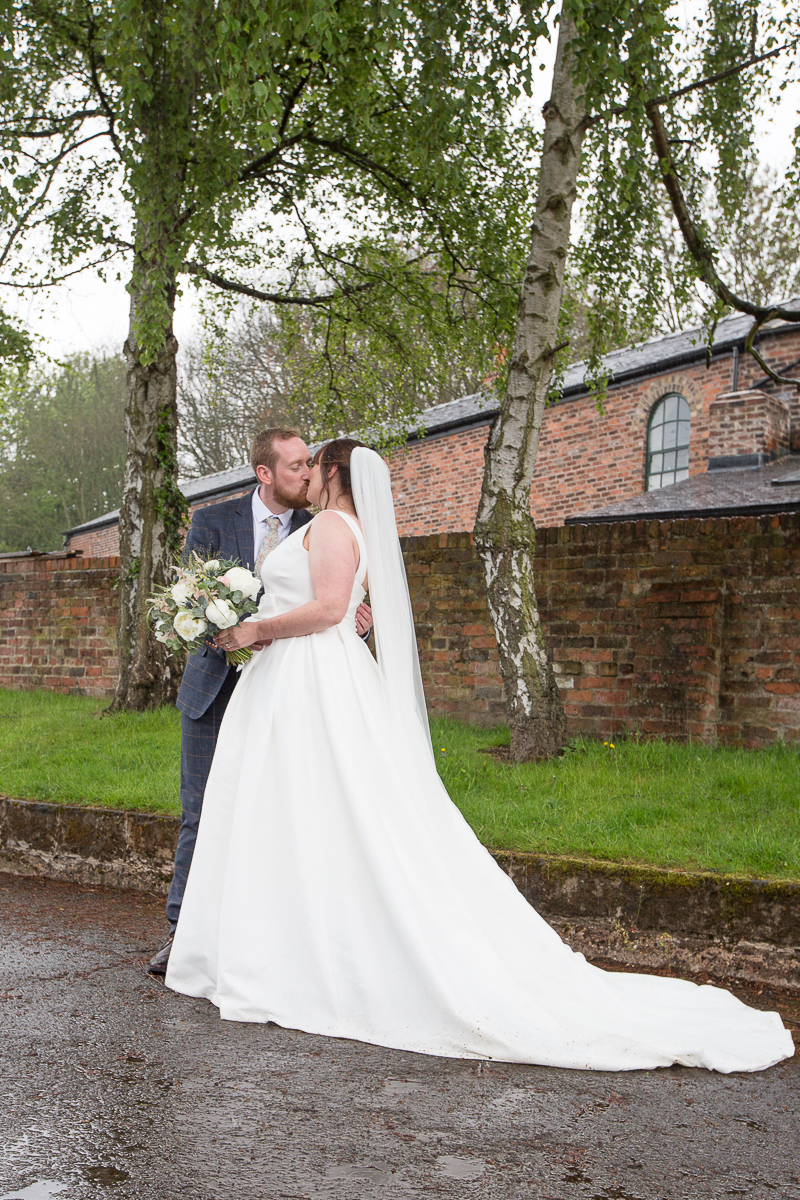 Couple kiss at Elsecar Heritage Centre on their wedding day