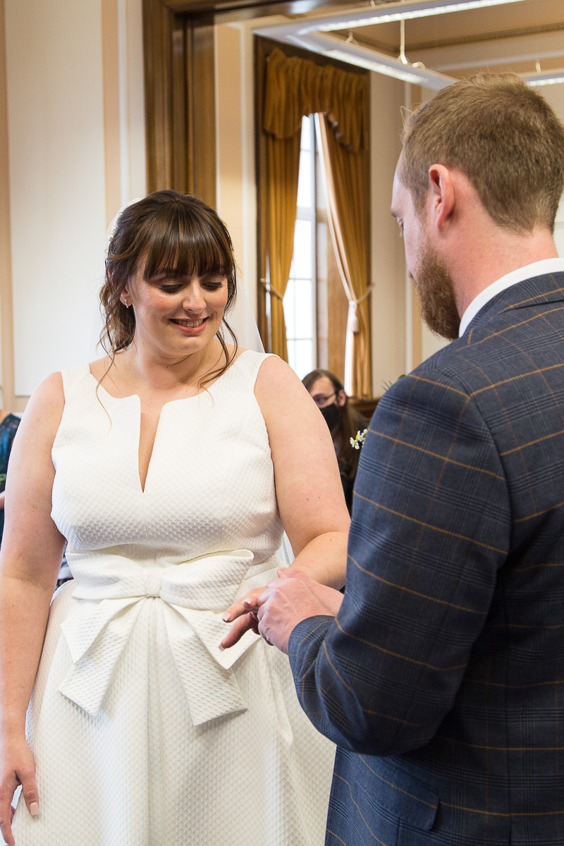 Couple exchange rings at Barnsley Town Hall wedding Photographer South Yorkshire