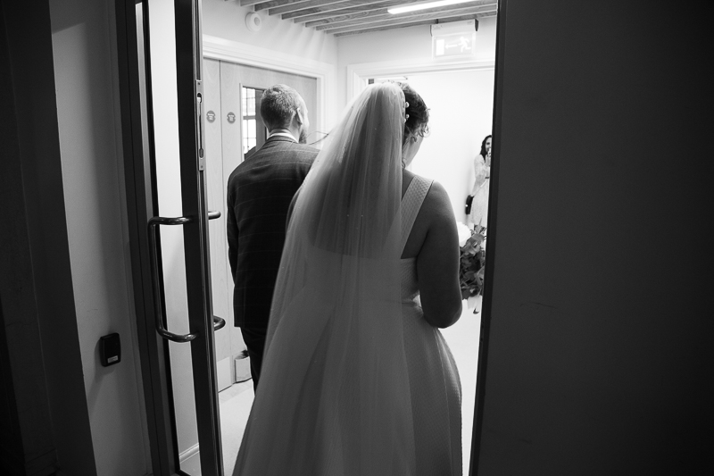 Bride and groom leaving the wedding ceremony room at Barnsley Town Hall
